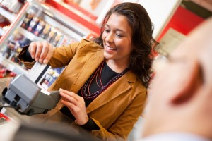 1794341-shop-assistant-smiling-while-swiping-credit-card-in-supermarket (1)